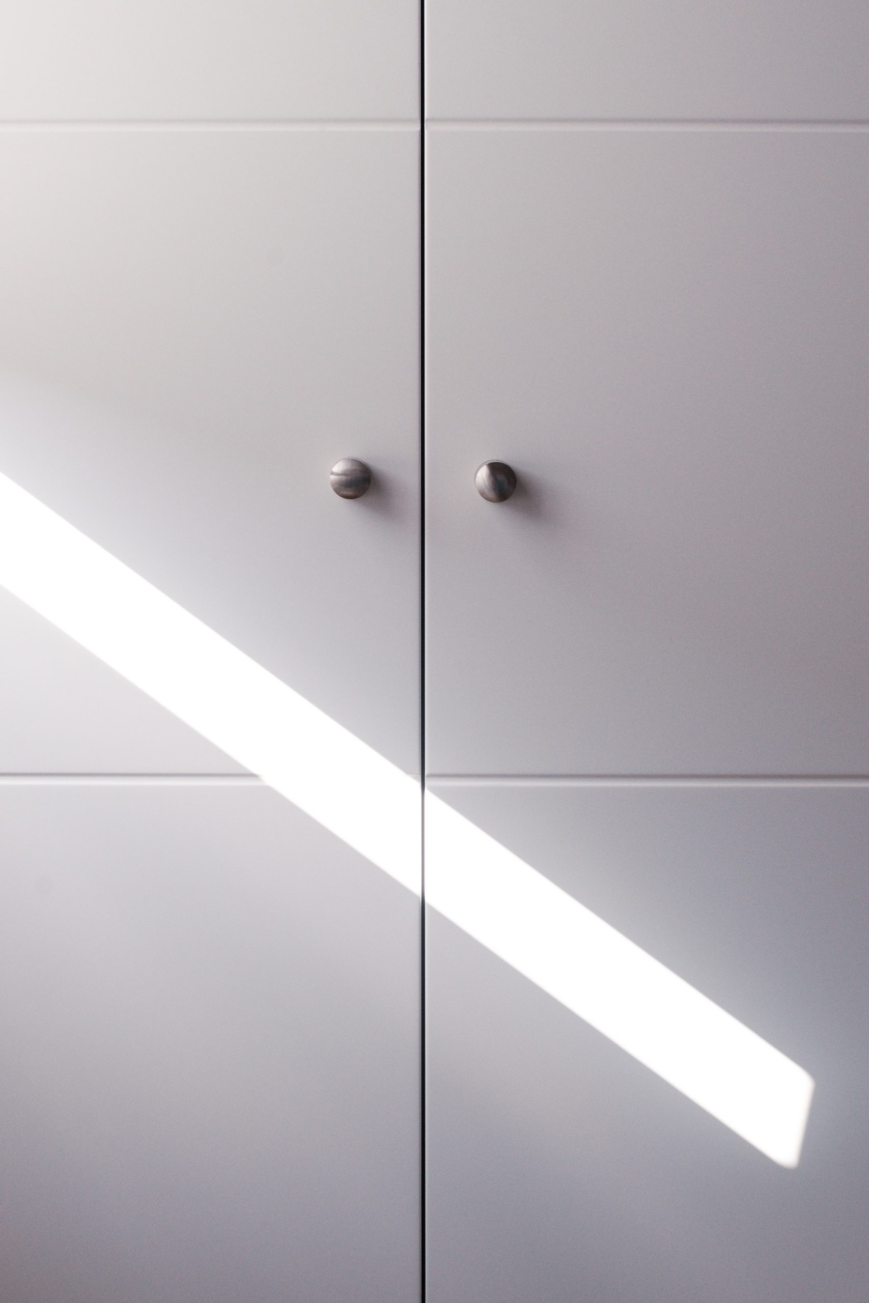 A close up of a new white wardrobe