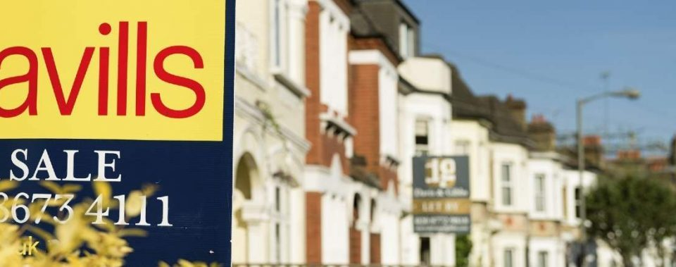 Savills for sale sign outside a row of houses